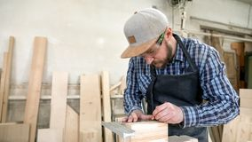 Experienced carpenter work with wooden stock images