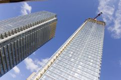 Close up of crane on top of high rise building Stock Photo