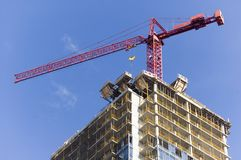 Close up of crane on top of high rise building Royalty Free Stock Photos