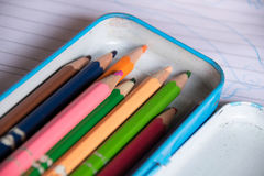 Close up crayon in box on note Royalty Free Stock Images