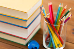 Close up of crayons or color pencils and books Royalty Free Stock Image