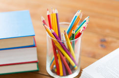 Close up of crayons or color pencils and books Royalty Free Stock Images