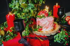 Close up of creamy cake, derorated with roses. royalty free stock images