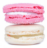 Close up creamy white and rose pink french macaroons on white ba Stock Photos