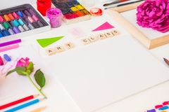 Close up creative artist workplace. Blank Canvas, Art class lettering on wooden blocks and colorful painting materials on white. Background. Art therapy royalty free stock photo