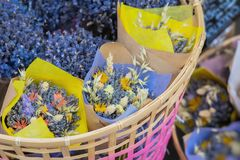 Close-up of creative bouquets of fresh lavender flowers in wicker basket, flower shop, studio. Delivery of flowers Royalty Free Stock Photography