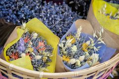 Close-up of creative bouquets of fresh lavender flowers in wicker basket, flower shop, studio. Delivery of flowers. Close-up of creative bouquets of fresh Royalty Free Stock Photo