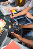 Close up of creative business people with digital camera Stock Photos