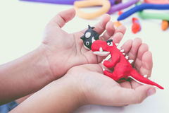 Close up. Creative clay model, on white background. Education co. Close up. Creating red dinosaur and whale clay model, on white background. Animals from play Stock Images