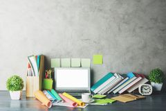 Contemporary desktop with empty white laptop stock image