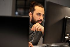 Close up of creative man working at night office stock photo