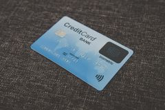 Close up of credit biometric card belonging to abstract cardholder lying on coarse fabric. E-shopping using advantages of. Fingerprint scanning. Simplicity and stock photo