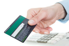 Close-up of credit card in human hand. Royalty Free Stock Image