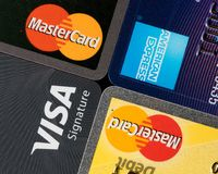 Close up of credit card issuer brands and logos