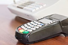Close-up of credit card reader on the cash register background. Royalty Free Stock Photography