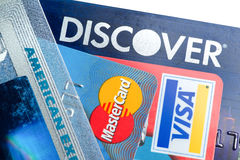 Close up of credit cards with Discover,American Express,visa and MasterCard logos on white background,illustrative editorial Royalty Free Stock Image