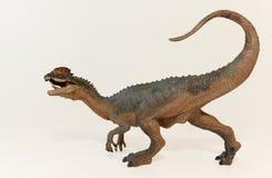 A Close Up of a Crested Dilophosaurus Dinosaur Stock Image