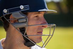 Close up of cricketer wearing helmet. While playing at field stock images