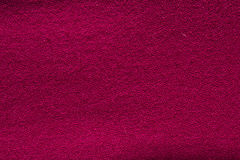Close up crimson woollen knitted fabric texture. Loden background Stock Images