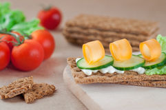 Close up of crispbreads with cheese, cucumber and carrot Royalty Free Stock Photography
