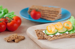 Close up of crispbreads with cheese, cucumber and carrot Royalty Free Stock Photos