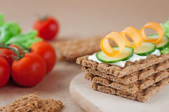 Close up of crispbreads with cheese, cucumber and carrot Stock Photos