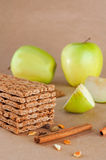 Close up of crispbreads with taste of apple and cinnamon. Healthy food concept: Close up of crispbreads with taste of apple and cinnamon on the light brown Stock Photos