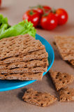 Close up of crispbreads with vegetables Royalty Free Stock Images