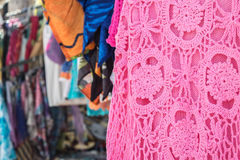 Close up of crocheted dress at handcraft vendor stall Stock Images