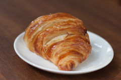 Close-up croissant on white plate. Stock Image