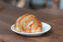 Close-up croissant on white plate. Royalty Free Stock Images