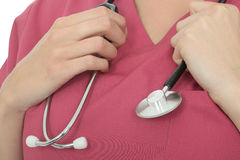 Close Up Crop Of A Young Female Doctor Holding A Stethoscope Royalty Free Stock Photography