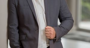 Close up cropped caucasian man hands and arms. In a smart grey suit Royalty Free Stock Images