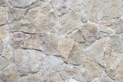Close up cropped geometrical smooth rough detailed textured brown concrete and grey gray stone wall on hose castle texture of ston Royalty Free Stock Photos