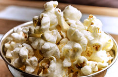 Close-up cropped image of popcorn over wood background Royalty Free Stock Photo