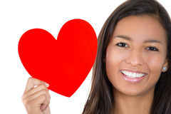 A close-up cropped image of a smiling young woman holding a heart, Stock Photos
