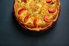 Close-up cropped photo of classic quiche lorraine pie with tomat Royalty Free Stock Image