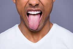 Close-up cropped portrait of his he handsome attractive well-groomed virile funky guy wearing white shirt showing tongue. Out over gray violet purple pastel royalty free stock photos