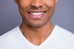 Close-up cropped portrait of nice handsome attractive cheerful cheery well-groomed guy wearing white shirt beaming shine. Teeth over gray violet purple pastel stock images