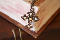 Close up of Cross. In the form of Jewellery on a wooden Jewellery box Royalty Free Stock Images