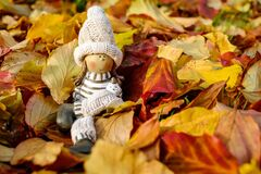 Close-up of Cross on Autumn Leaves Royalty Free Stock Images