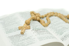 Close up of cross lying on open Holy Bible Royalty Free Stock Image