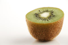 A close-up of a cross section of an organic kiwi fruit stock photo