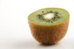 A close-up of a cross section of an organic kiwi fruit Stock Photo