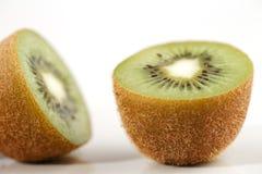 A close-up of a cross section of an organic kiwi fruit Stock Photos
