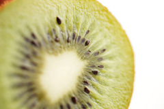 A close-up of a cross section of an organic kiwi fruit Royalty Free Stock Image