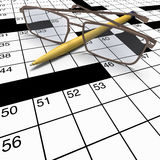 Close up crossword with pen and spectacles. Extreme close up of crossword puzzle with yellow pen and spectacles in wide angle lens view Stock Image