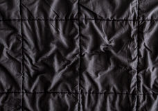 Close up  on Crumpled black fabric with seam line texture Stock Image
