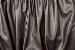 Close up on crumpled black leather material textured fabric. Stock Photography