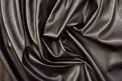 Close up on crumpled black leather material textured fabric. Stock Photos